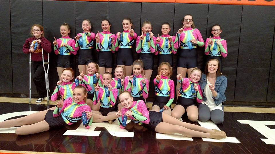 JUST FOR KIX team took first at the Moorhead Meet.