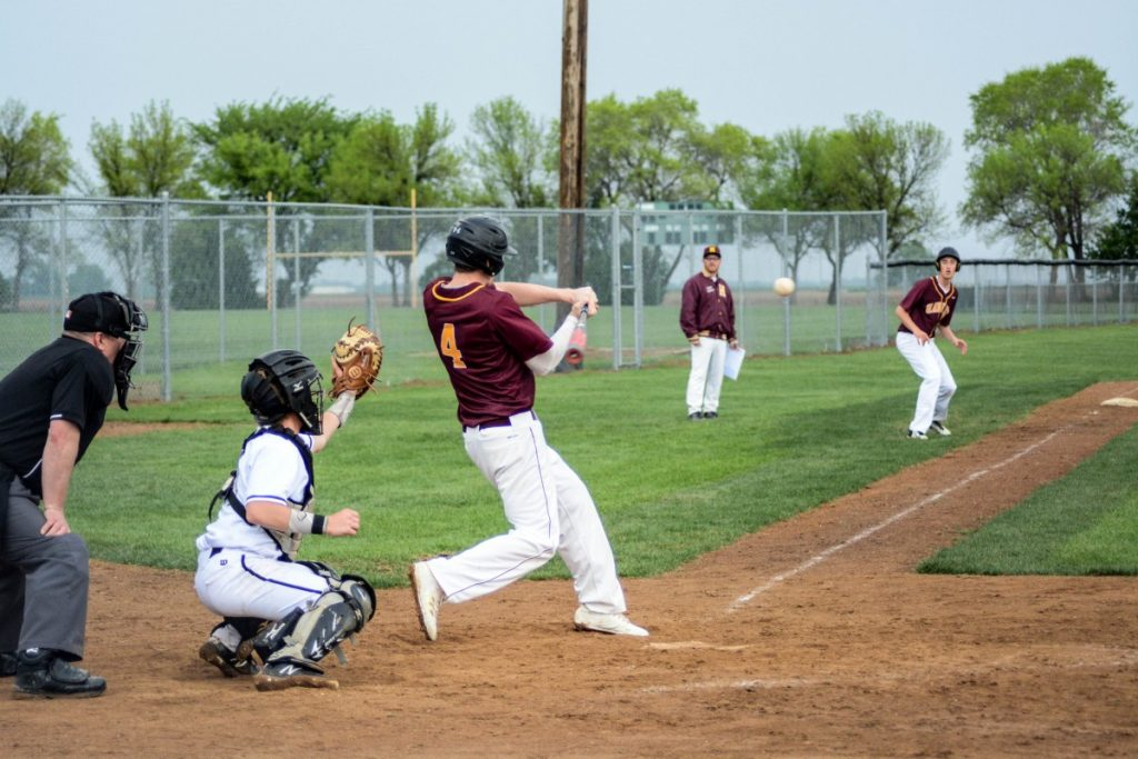 Gunnar riffles this ball for the Nuggets. Also pictured in George Pasche at third and Coach Lofgren. (photo by Breana Orlando)