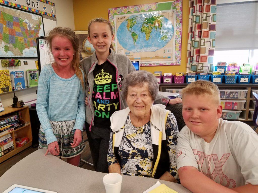 Audrey Dauner with three of her twenty-six grandkids.