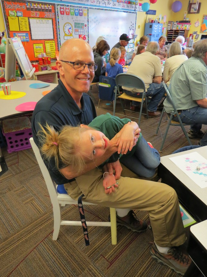 Bill Gottenborg sits with one of his grandchildren during Grandparent's Day 2018.