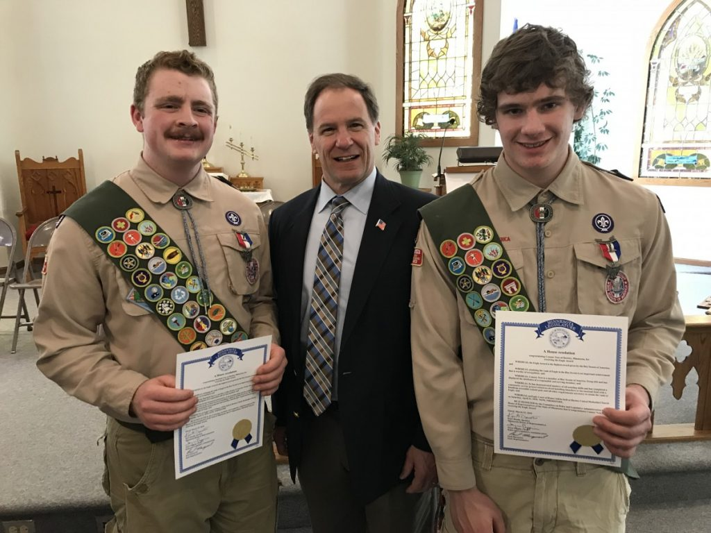 Eagle Scouts Marshall Ness and Connor Ness stand with Rep. Paul Marquart.