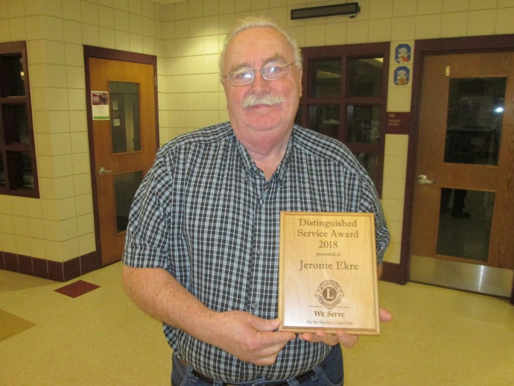 Jerome stands with his award. What a great friend to everyone especially the Hawley Herald.