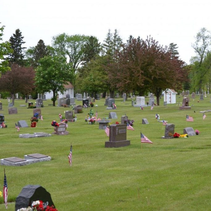 The Memorial Program is canceled, but the flags will still be placed in the cemetary to honor those who've passed